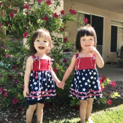 Baby photo album | LLU Center for Fertility | Girls in matching July 4 outfits